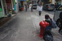 Students taking measurements from traverse stations in the Hong Kong geodetic network